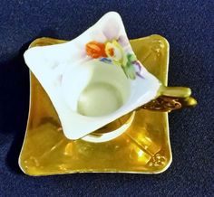 VINTAGE MINITURE  CUP AND SAUCER MADE IN JAPAN GOLD WITH HAND PAINTED FLOWERS  #DEMITASSE