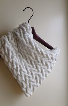 This cowl is as fun to knit as it is fun to wear. Pattern: http://3rabbitspatterns.blogspot.co.uk/2015/04/white-cable-cowl-knitting-pattern.html