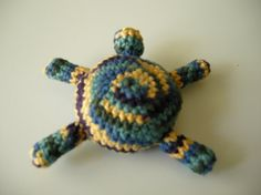 Amigurumi Turtle Dog toy by athenaknits on Etsy, $4.99A puppy toy that bears a resemblance to a colorful turtle. I have a slightly smaller version of this toy, in a different color set. This is a tough toy able to withstand tugging and chewing with surprising resilience. Perfect for playing fetch and tug of war. If the toy does happen to meet its untimely end, the filling is in strips so it is easy to pick up.