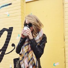 leather jacket, scarf and sunnies.