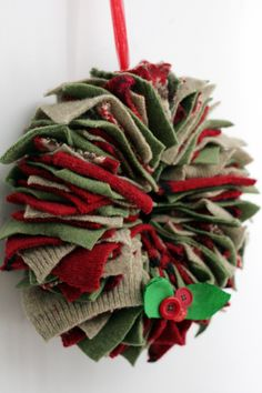 This wreath is made with cut up old sweaters and a wire coat hanger... can you say free project!!! If you don't have any sweaters you are willing to cut up, just run to good will and get some old ones in whatever colors you want.