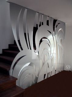 Paravan despartitor din inox, cu rol de balustrada scara interioara, metal decupat, comanda design interior | These are two decorative pieces of laser cut stainless steel designed for a staircase. The stainless steel works were designed and executed as a …
