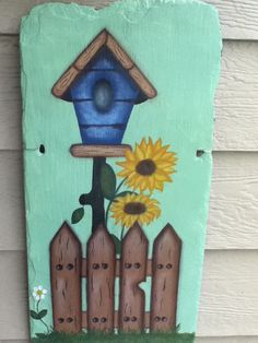 Another of Jenny's paintings, painted on slate, currently hanging on our patio.