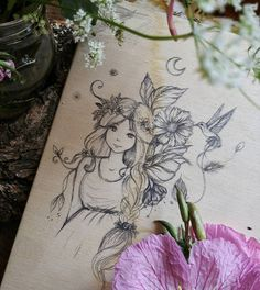Original pencil drawing of a Fairy on wooden table. I have always loved to draw these magical creatures and lately looking back over my…