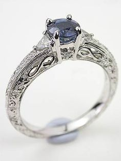Blue Sapphire Engagement Ring with Infinity Design