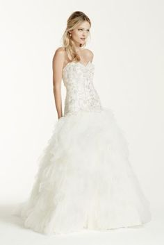 This ruffled skirt ball gown takes bridal glamour and sophistication to the next level!  Strapless sweetheart bodice features delicate beaded lace detail.  Lace-upback shapes a flattering silhouette while ensuring the perfect fit.  Eye-catching and dramatic ruffled skirt adds dimension and finishes of the look.  Chapel train.