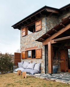 Warm mountain house blending rustic and modern in Spain Located in rural Spain, this warm mountain house has a rustic exterior symbolic of its surroundings, with a contemporary interior designed by Alfons Tost.Modern Yet Warm And Cosy Winter House : Rustic Exterior, Exterior Design, Rustic Outdoor, Outdoor Seating, Outdoor Decor, Stone Houses, Style At Home, Cozy House, Cozy Cabin