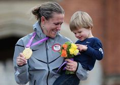 Kristin Armstrong wins Gold in Cycling! She retired after Beijing Olympics in 2008, had a baby boy (in picture), and then came back for the London 2012 Olympics, winning the Gold!
