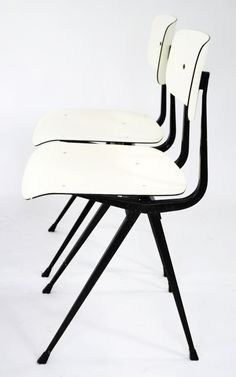 Result chairs designed by Friso Kramer in the 1950s and produced by Ahrend de Cirkel. These 1970s version have a white seat and back made from formica
