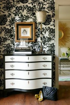 I like the entire idea of this wall/dresser/art. I think I would flip the lamp shade back to normal though...