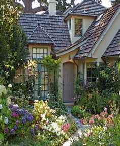 Adorable cottage surrounded by a fairytale garden More