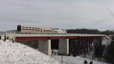 Amtrak crossing the Upper Falls Bridge (photo courtesy Ken Wallace)
