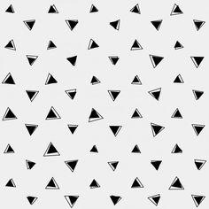 Fondo gris con triángulos negros Vector Gratis