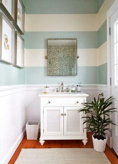 If you want to add color to your powder room, but want to do so in a unique way, consider painting wide, horizontal stripes on the wall. This graphic design element  brings movement to the space and helps open it up.