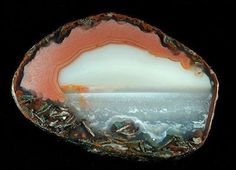 An incredible agate. Looks like you're in a cave looking out at a lake.
