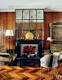 Button-tufted velvet seating and herringbone parquet are featured in a Stephen Sills–designed living room in Manhattan.