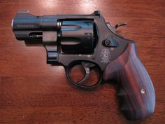 S&W 327 NG .357 Magnum with Ahrend's grips. 2.5 inch Barrel, holds 8 rounds, respectable accuracy for a snub nose with manageable recoi