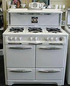 """40"""" Wedgewood - 6 burners, double ovens = perfection.  This company is currently restoring the same stove with glass oven doors...could be my new stove!"""
