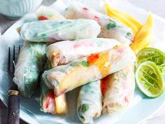 Enjoy these light, refreshing chicken and mango rice paper rolls on a warm summer's afternoon. A Vietnamese classic, the rolls are wonderful served as finger food with a zesty chilli lime dipping sauce.