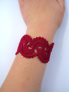 I made this elegant and intricate bracelet with 100% cotton crochet thread using a Queen Anne's Lace design. The bracelet is rounded at each end with a button closure. The button allows the bracelet to be adjustable in size, just fasten in any of the lace loops that fit your wrist. The bracelet c...