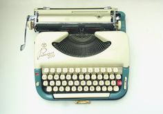 blue working typewriter 1950s mid century by thespectaclednewt