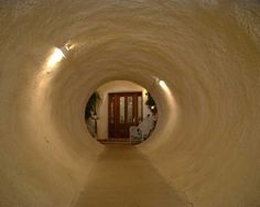 Underground Tunnel — Made of corrugated steel, the tunnel leading to the front door has a concrete pathway and lighting.  (Underground Monolithic Dome home)