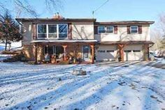 SOLD!  $154,900  E4820 Timmons Rd~La Valle, WI Beautifully updated 3BR/2BA Raised Ranch within walking distance to Lake Redstone! Granite countertops in the light & bright kitchen, dining area w/access to the private backyard deck. TWO living areas, TWO fireplaces! 1.66 Acres. Fruit trees & flower gardens to color your life!