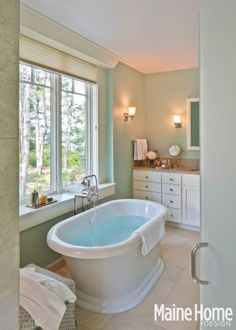 Visual Comfort wall sconces in bath vanity.  Maine home featured in Maine home and Design magazine.