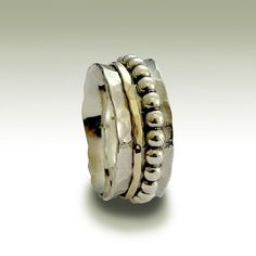 Aint gonna let you go ~~~~~~~~~~~~~~~~~~~~~~ This unisex ring makes a beautiful wedding band for both him and her. The main band is hammered sterling