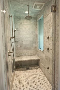 Marble shower with brushed nickel rain shower head, seamless glass ...