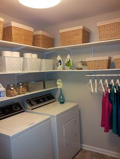 Laundry Room Makeover- so awesomely organized! flowers are a little over the top though
