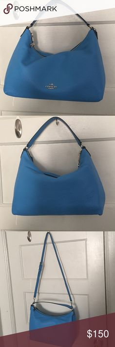 Coach purse - NWOT Can be worn two ways as is a beautiful color. She's ready for summer. Pebbles leather, and has one large zipper pocket. Two smaller pockets for keys and/or cell phone. Coach Bags Shoulder Bags