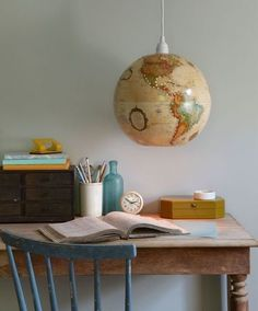 vintage upcycled world globe pendant lights with desk and chair for indoor decoration