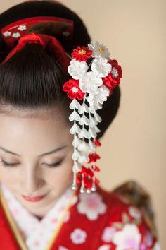 Pretty kimono girl adorned by silk kanzashi (hair ornament) & lacquered comb
