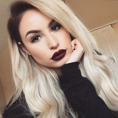 Dark lips, strong brows. Vampy make up.