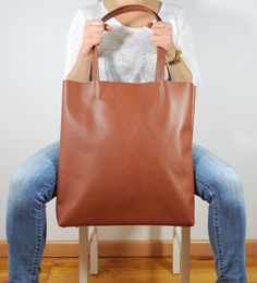 Simple elegant women bag made of high quality genuine leather    Simple design    Color: chestnut    Practical and following the newest fashion trends    No lining - raw finish    Made with care for details    Zipped    Inner zipped pocket        Dimensions:    width.: 39,5 cm - 15,55 inch    height : 40 cm - 15,75 inch    handles lenght 56 cm - 22,05 inch    bottom size: 11 x 30 - 4,33 x 11,81 inch    inner pocket: 21 x 13 cm - 8,27 x 5,12 inch        Thank you for visiting my shop!