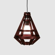 Plywood and iron come together in this modern industrial piece of lighting magic. KD01 is a gorgeous chandelier that isn't exceptionally feminine. Perfect for sparse spaces filled with metals, bricks, and other tough texture, it's a true room redefiner.