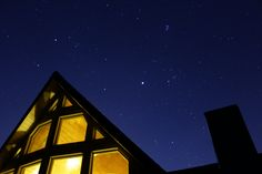 The bright moon is hidden behind the top of this Swiss Chalet located in the southern Adirondacks on a very cold night the glow of the house is mighty inviting.    --    Looking closely, you can see the Seven Sisters (Pleiades) constellation towards the middle/top of the photo.