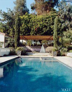 Cypress trees frame the pergola next to the pool at Amanda Peet's house in California  // Great Gardens & Ideas //