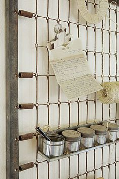 Need over-the-desk storage? Prop a vintage metal bed frame against the wall, and add shelves, file holders, and clips to the springs for a unique salvage-style solution. via @apttherapy