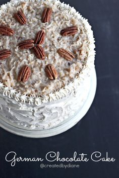 German Chocolate Cake with Coconut Pecan Frosting and Filling. #food #cakes #desserts