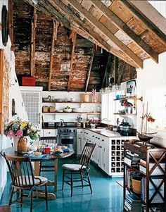 I love the contrast between old/ rustic and shiny new.  Makes me want to get in the attic and see what our house would look like if I ripped out the ceiling.
