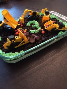 Oreo Digger Dirt Cake with CAT Mighty Machines Diggers. Traditional Oreo Dirt Cake recipe- added Reese's Pieces and Mini Cups. Piped icing for grass. 3 year old boy birthday cake. Construction cake.