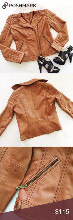 """Michael Kors Leather Moto Jacket Michael Kors Leather Moto Jacket in supple cognac leather.  Classic biker jacket in a trendy neutral color.  Pre-loved but in great condition.  Small stains, see pics.  Lighting is slightly off in last pic, true color in all other pics.    Measurements laying flat: Armpit to armpit: 18"""" Waist (across): 16"""" Total length: 21"""" Sleeve length: 24"""" Michael Kors Jackets & Coats"""