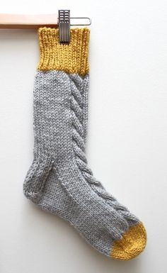 Colour-block Slipper Sock knitting pattern by designer Jessica Biscoe. These socks are perfect for going around the house on cold days, get the Downloadable PDF knitting pattern from loveknitting.