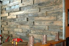 Behind staircase wall - wallpaper replacement Pallet Fireplace, Stick On Wood Wall, Reclaimed Building Materials, Reclaimed Wood Bars, Wood Lumber, Old Barn Wood, Into The Woods, 3d Texture, Repurposed Wood