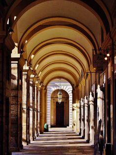 Arcade in lights and shadows. Turin, Piazza del Municipio