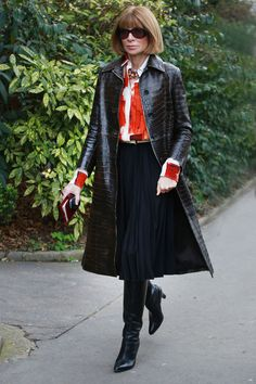 street style: Paris Fashion Week Fall 2014... Anna Wintour only covers up with the most luxe of coats. Source: Tim Regas