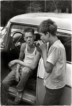 "Leatherwood, Kentucky, 1964. ""Cornett boys smoking by car."" No after-school soccer for these lads. Print from a 35mm negative by William Gedney."