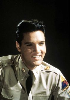 """*ELVIS during a photo shoot for his first movie since being discharged from the Army...""""G.I. Blues""""."""